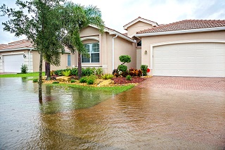 image of flood waters moving toward home